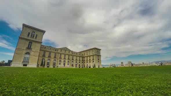 Thumbnail for Aix-Marseille University Building, Spacious Green Lawn Near Entrance, Timelapse