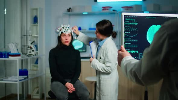 Stressed Patient Sitting on Neurological Chair with Eeg Headset