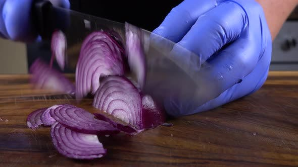 Thumbnail for The Cook Cuts Onions
