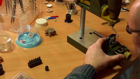 Thumbnail for Watchmaker Uses Drill Press
