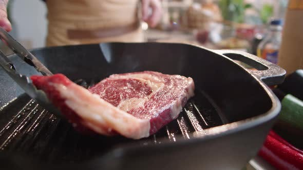 Thumbnail for Male Chef Putting Meat Steak on Grill Pan