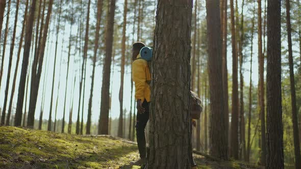 A Young Couple of Black Men and Women Walk in the Woods During a Trip to the Woods with Backpacks in