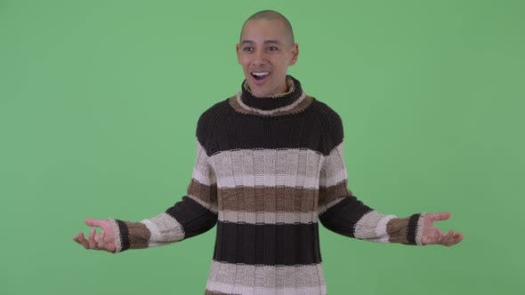 Thumbnail for Happy Bald Multi Ethnic Man Looking Surprised Ready for Winter