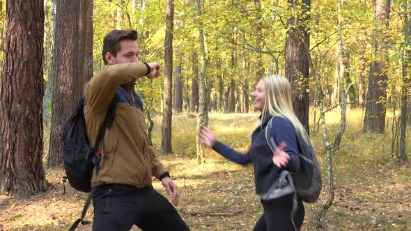 Thumbnail for A Hiking Couple Dances in a Forest