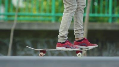 A skateboarder speeding