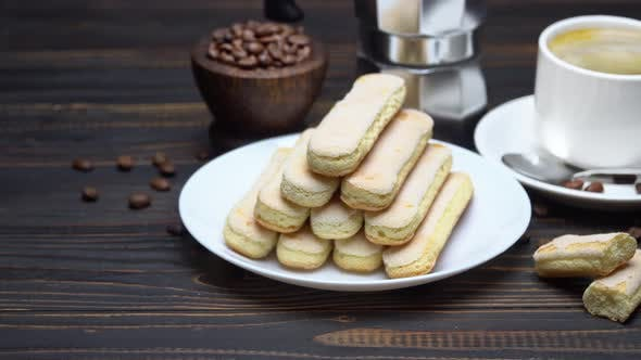 Thumbnail for Italian Savoiardi Ladyfingers Biscuits and Cup of Coffee on Wooden Background