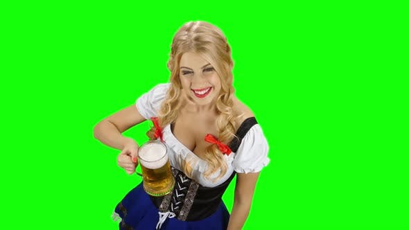 Thumbnail for Girl in Bavarian Costume Drinking Beer and Shows the Thumb. Green Screen