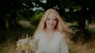 Beautiful Blonde Woman Walking and Looking Into Camera