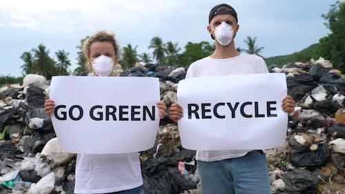 Pollution Environmental Contamination - Activists Couple on Disposal Site.