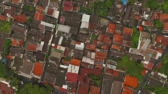 Thumbnail for Aerial Rotating Birds Eye Overhead Top Down View of Bright Red and Orange Rooftops of Houses in