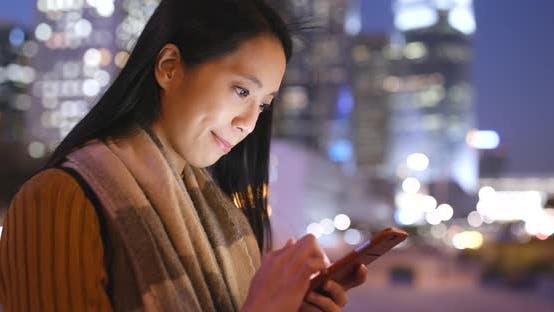 Thumbnail for Woman Use of Smart Phone in Hong Kong City at Night