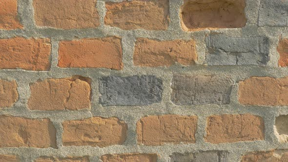 Brick wall details 4K 2160p UHD panning video - Bricks in the wall lighted 4k 3840X2160 UHD footage