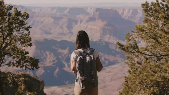 Thumbnail for Happy Beautiful Young Woman with Backpack Walking Up To Amazing Summer Landscape Scenery of Grand