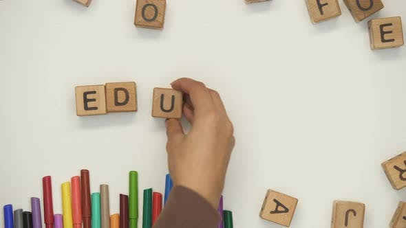 Thumbnail for Education Word on Cubes Made by Teacher and Child, Early Development, Preschool