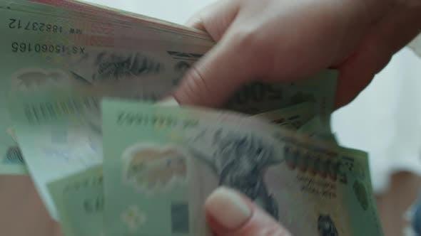 Woman Counts Money