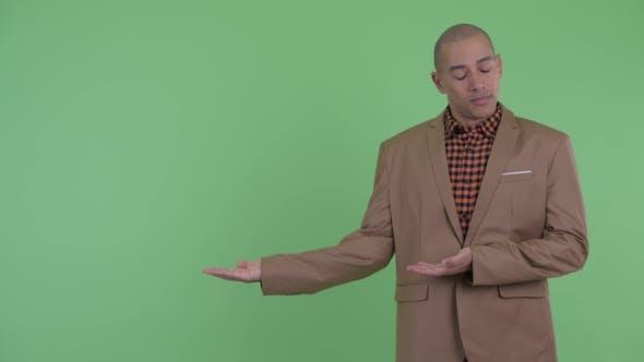 Thumbnail for Sad Bald Multi Ethnic Businessman Showing Something