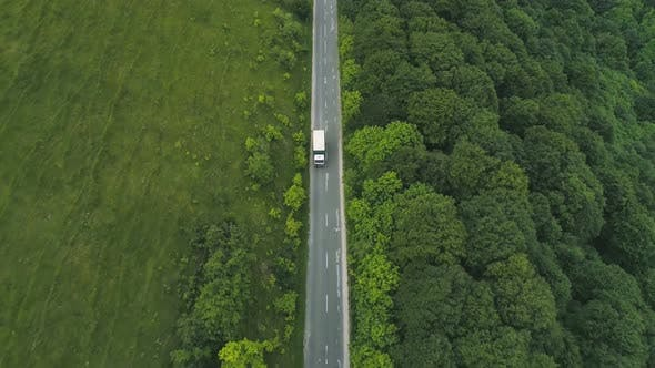 Thumbnail for Drone Follows White Truck on Straight Mountain Road