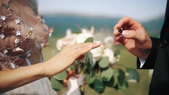 Groom Puts Wedding Marriage Ring Finger Bride