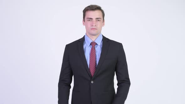 Thumbnail for Young Happy Handsome Businessman Smiling with Arms Crossed