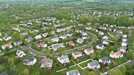 Aerial view over suburban homes and roads aerial view of residential