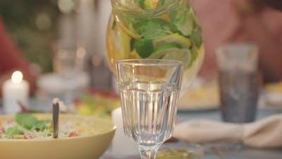 Pouring Fresh Lemonade Into Glass