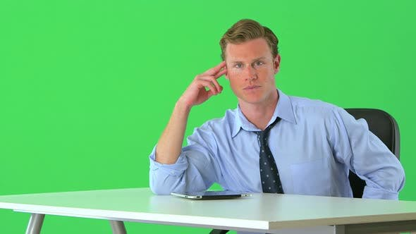 Thumbnail for confident businessman sitting at his desk on greenscreen