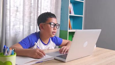 Asian Boy Student Video Conference E-Learning With Teacher On Computer