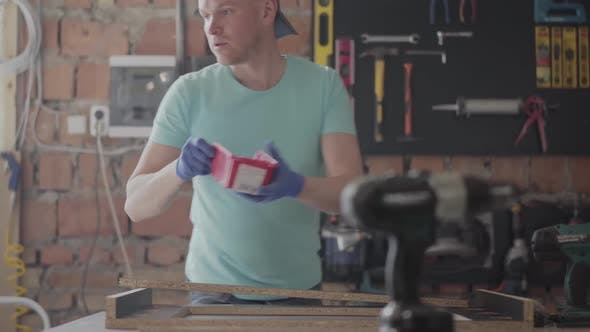 Thumbnail for Portrait Skilled Carpenter Cutting a Piece of Wood in His Woodwork Workshop, Using a Circular Saw
