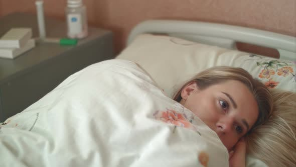Thumbnail for Female Patient Wakes Up in a Hospital Bed