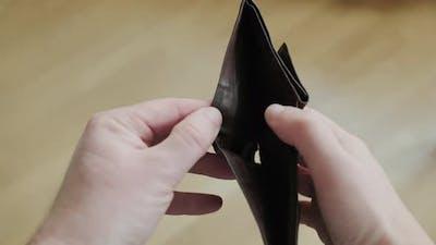 Man Bankrupt Arrears Showing Empty Wallet with No Money