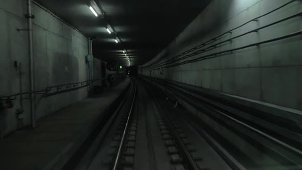 Thumbnail for Cabin View of Train Moving in Dark Subway Tunnel