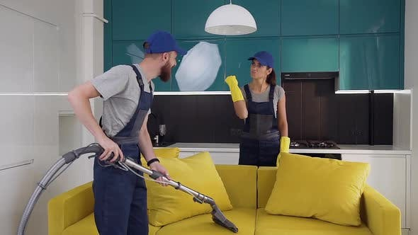 Thumbnail for Serious Young Woman from Cleaning Service Showing Her Male Partner