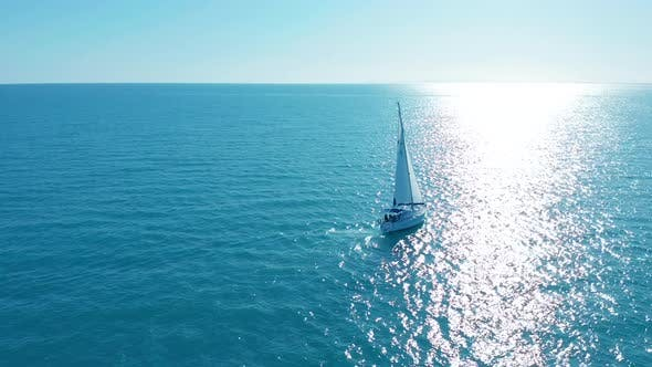 Thumbnail for Aerial View. Yacht Sailing on Opened Sea. Sailing Boat. Yacht From Above. Yachting at Windy Day.