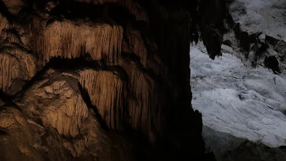 Thumbnail for Slow tilt on cave formations of stalactites and stalagmites 3840X2160 UltraHD  footage - Deep inside
