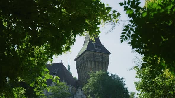 Thumbnail for Vajdahunyad Castle seen behind green branches