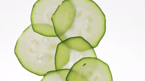 Thumbnail for Stop Motion How Appear and Filling All Frame with Zucchini Slices on White Table with Backlight