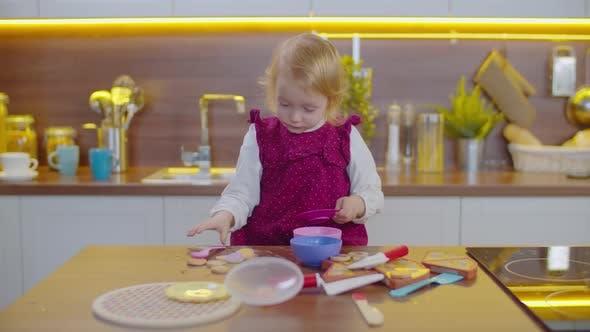 Cute Toddler Girl Playing Plastic Tableware