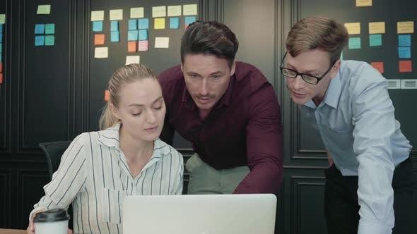 Team Working On Laptop