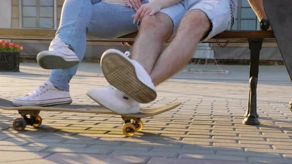 Thumbnail for Teenage Couple Is Posing with Skateboards in the City.