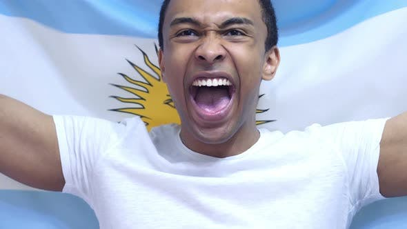 Argentinian Fan Celebrates Holding the Flag of Argentina