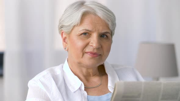 Thumbnail for Portrait of Senior Woman Reading Newspaper at Home