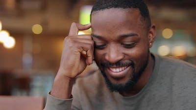 Shy African American Man Smiling Closeup