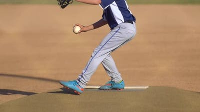 The pitcher in a boys little league baseball game.