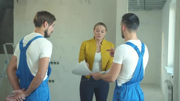 Thumbnail for Woman Shows a Drawing and Argues with Builders