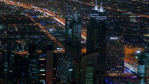 Dubai Cityscape Skyscrapers Panorama Night Time Lapse. Pan Up