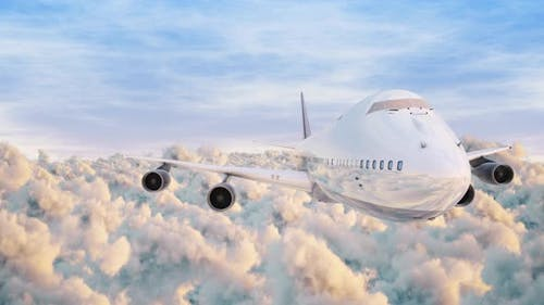 Airplane Jumbo Jet Front View Fyling Over Puffy Clouds Sunlight And Blue Sky Seamless Loop