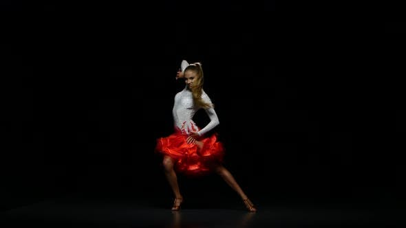 Thumbnail for Woman Dancing Cha-cha-cha in a Studio on a Dark Background