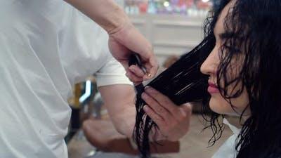 Man Hairdresser Combs His Hair