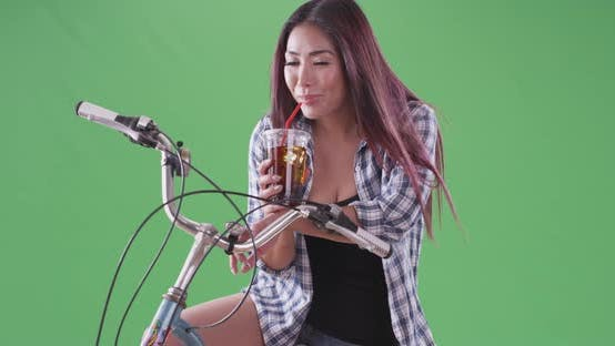 Thumbnail for asian woman smiling and drinking her tea on green screen