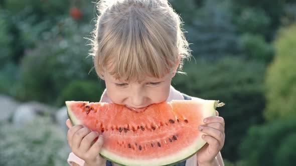 Thumbnail for Little Girl Enjoying Watermelon